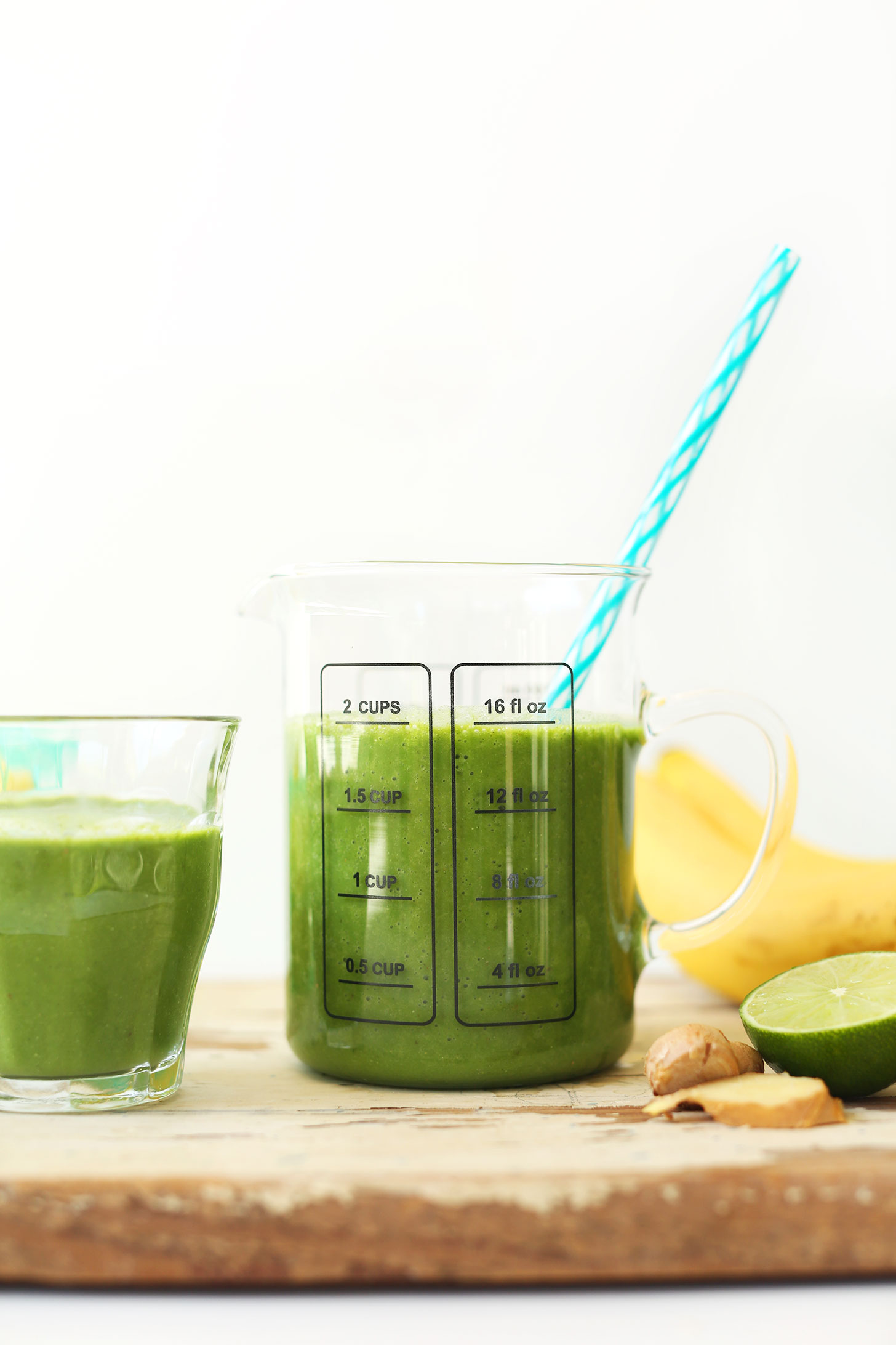 Measuring and serving glass with our Ginger Colada Green Smoothie recipe