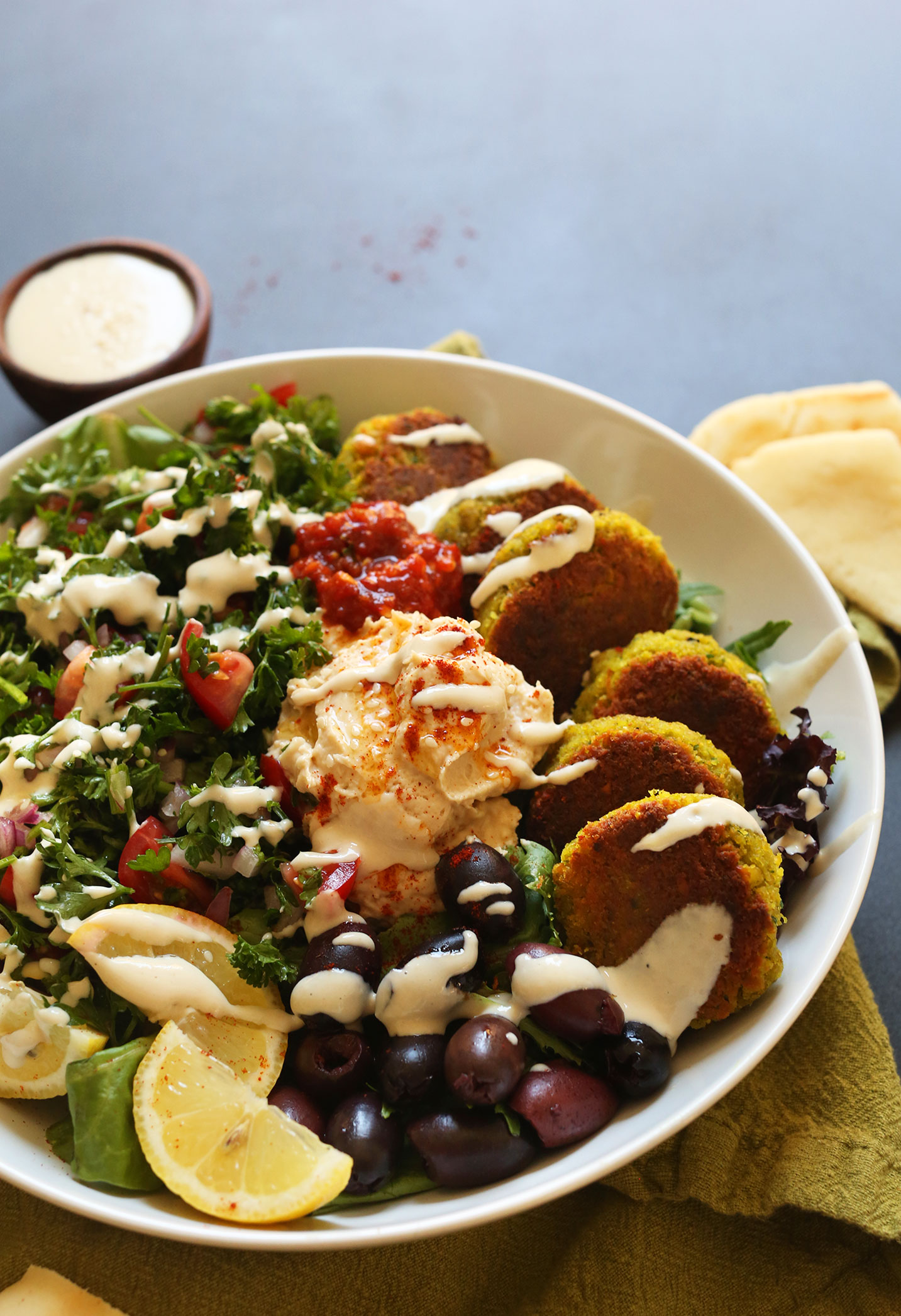 Tahini sauce drizzled over our vegan Mediterranean Bowl recipe