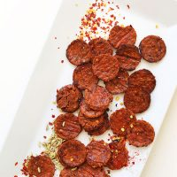 Tray with homemade Vegan Pepperoni, fennel seeds, and red chili flakes