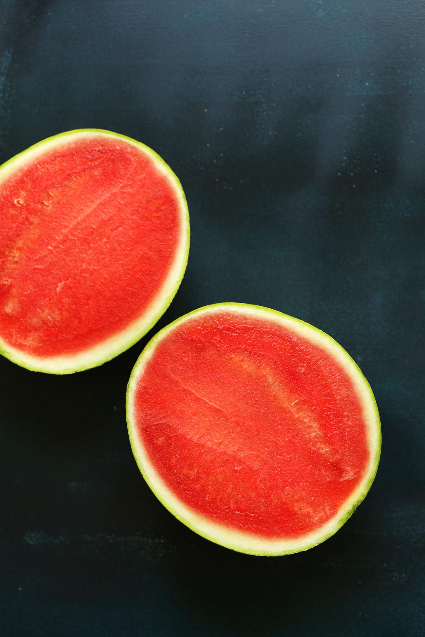 Halved fresh watermelon for making vegan Watermelon Sashimi