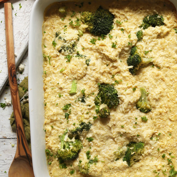 Cheesy Cauliflower Rice Broccoli Bake in a baking dish for a comforting plant-based dish