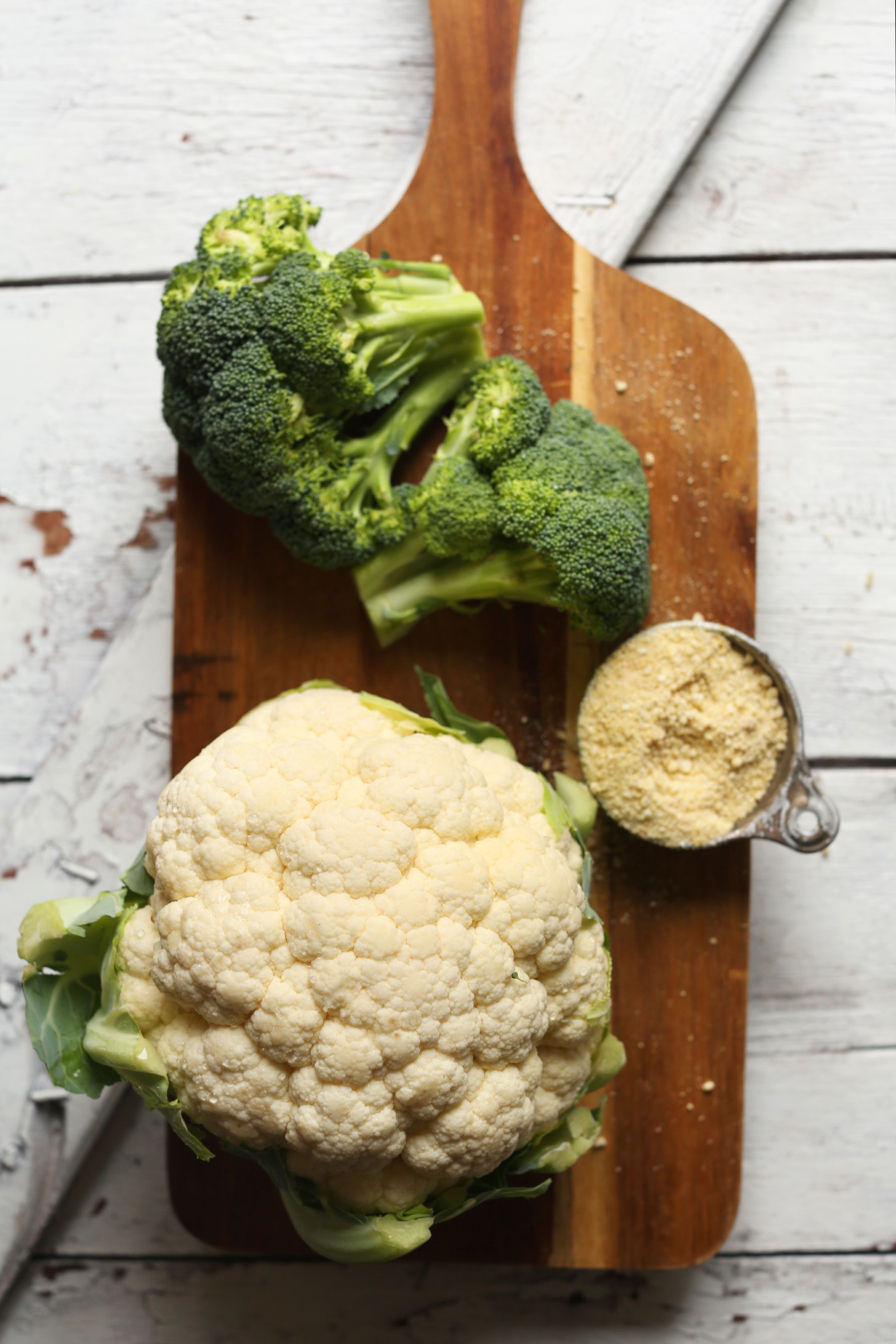 Broccoli, cauliflower, and vegan parmesan cheese for making healthy vegan comfort food