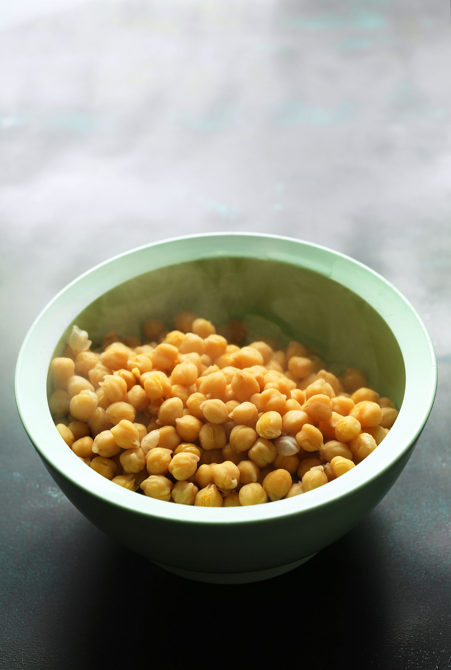Bowl of warm chickpeas for making our Healthy Quinoa Chickpea Buddha Bowls recipe