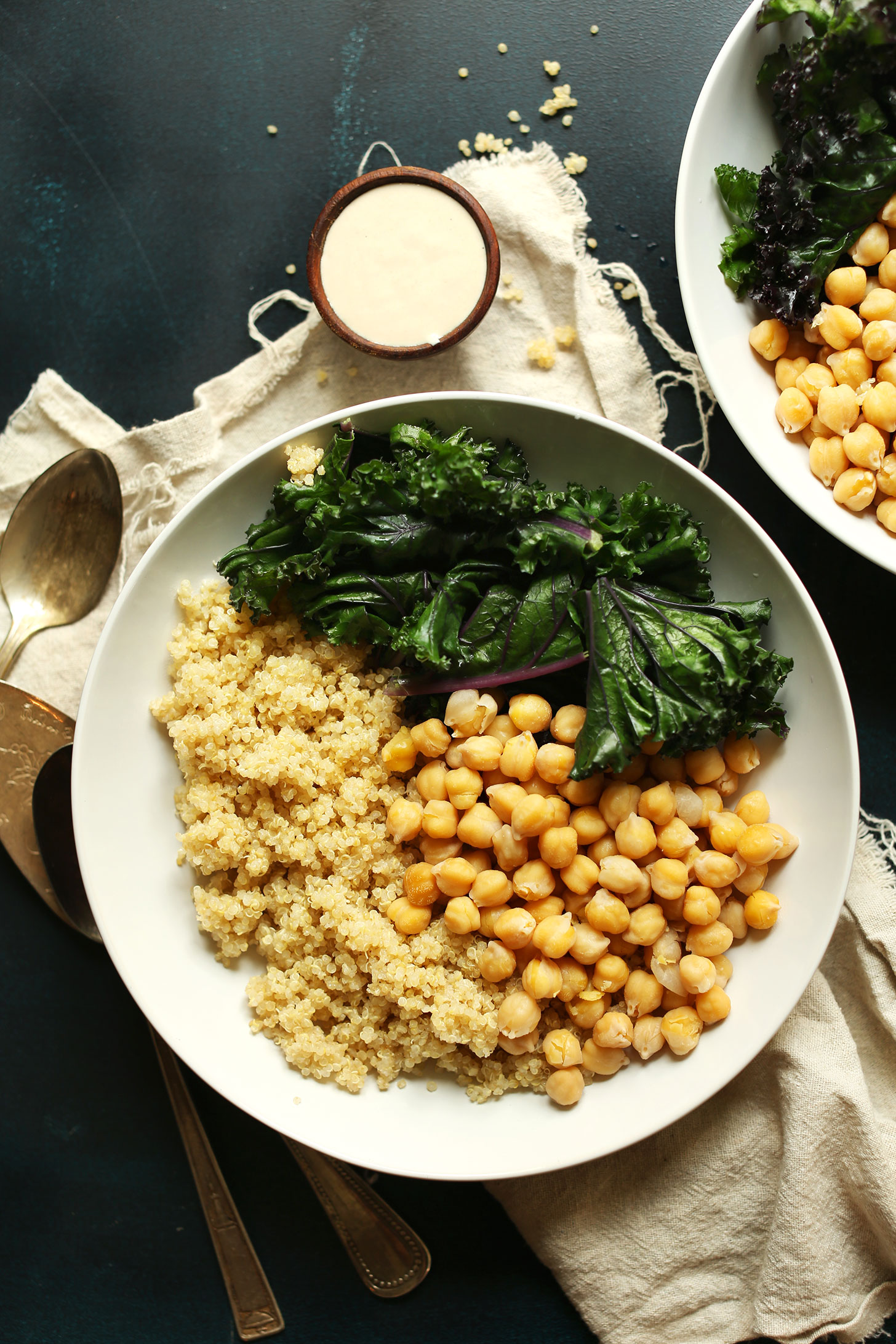 Quinoa Chickpea Buddha Bowls with Kale and Tahini Sauce for a simple plant-based meal