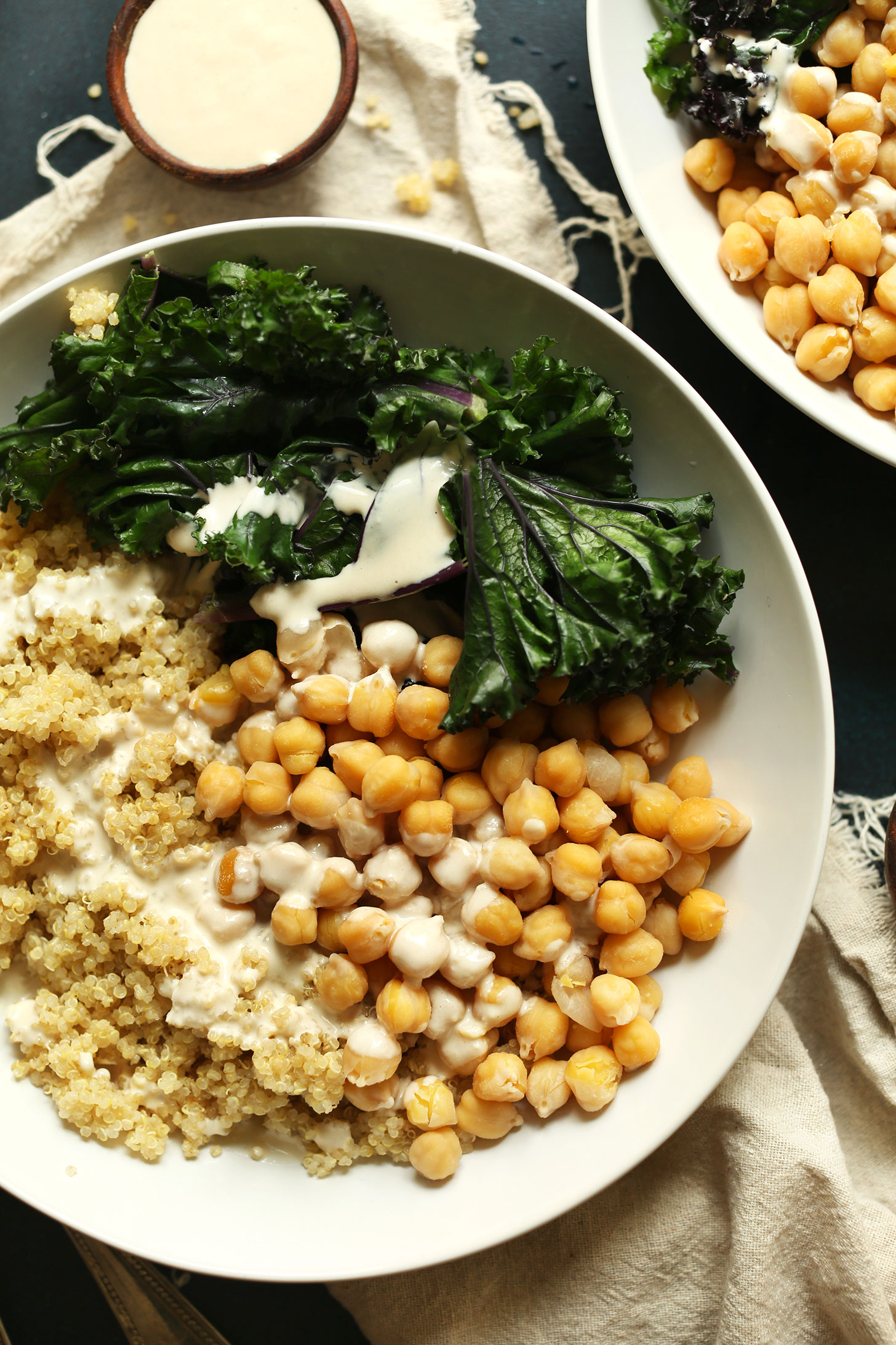 Servings of our Quinoa Chickpea Buddha Bowls with Kale and Tahini Sauce for a delicious plant-based meal
