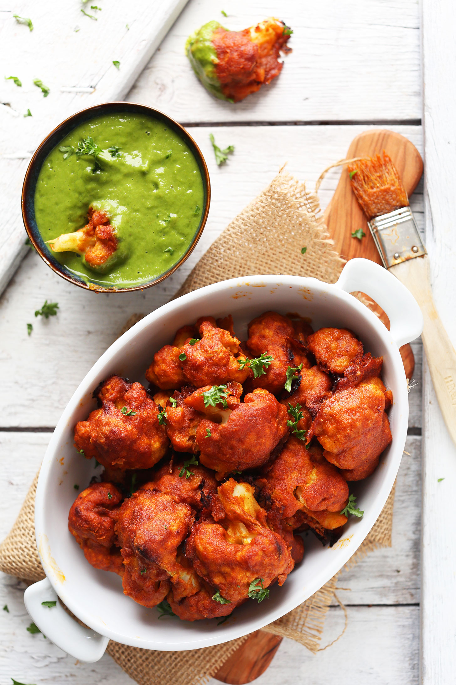 Bowl of Red Curry Cauliflower with Green Chutney for a vegan Indian recipe