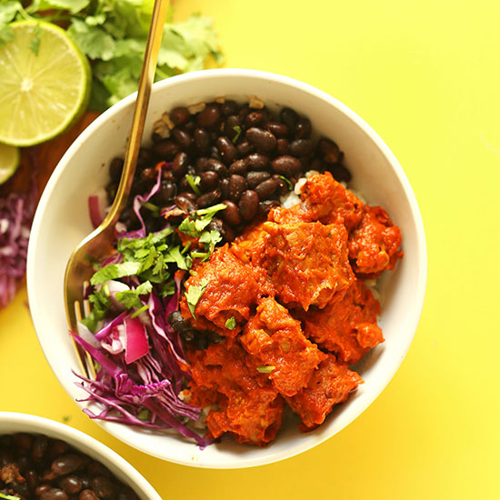 Gold fork in a Smoky Tempeh Burrito Bowl topped with fresh cilantro