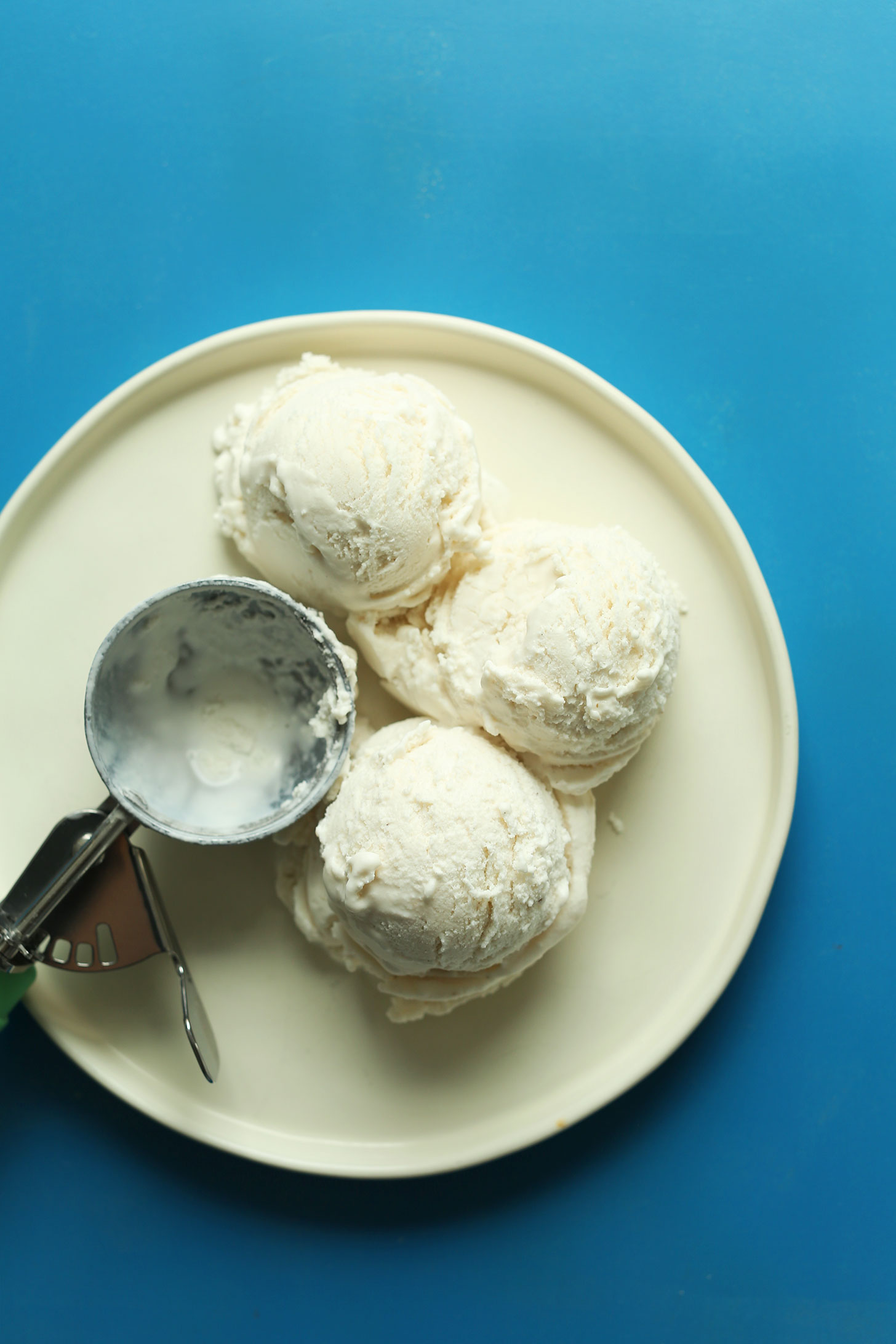 Three scoops of vegan vanilla coconut ice cream for making our Chocolate Malt Shake