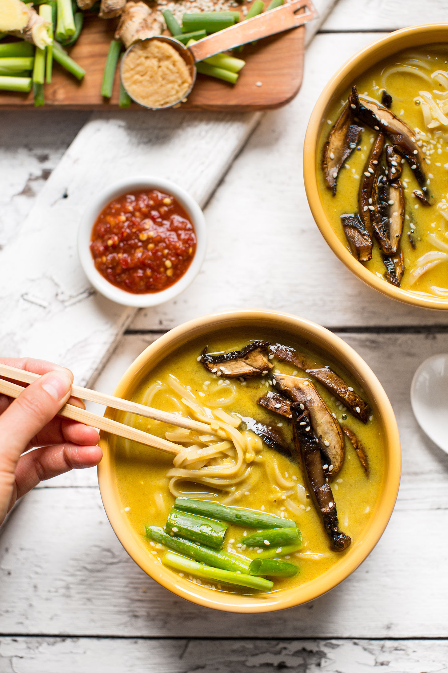 Using chopsticks to grab a bite of gluten-free vegan Coconut Curry Ramen