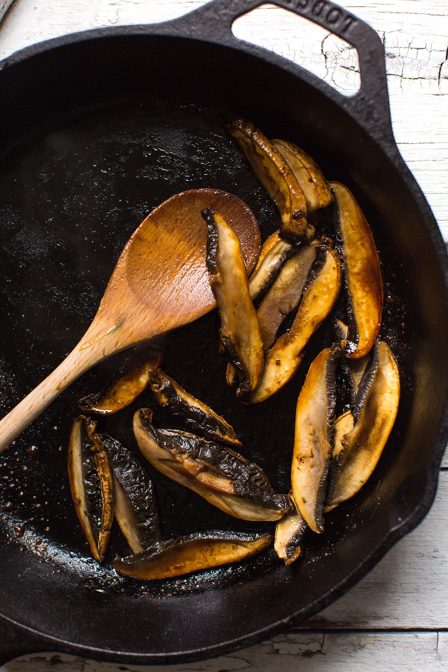Sautéing mushrooms in a cast-iron skillet for our gluten-free vegan Coconut Curry Ramen recipe