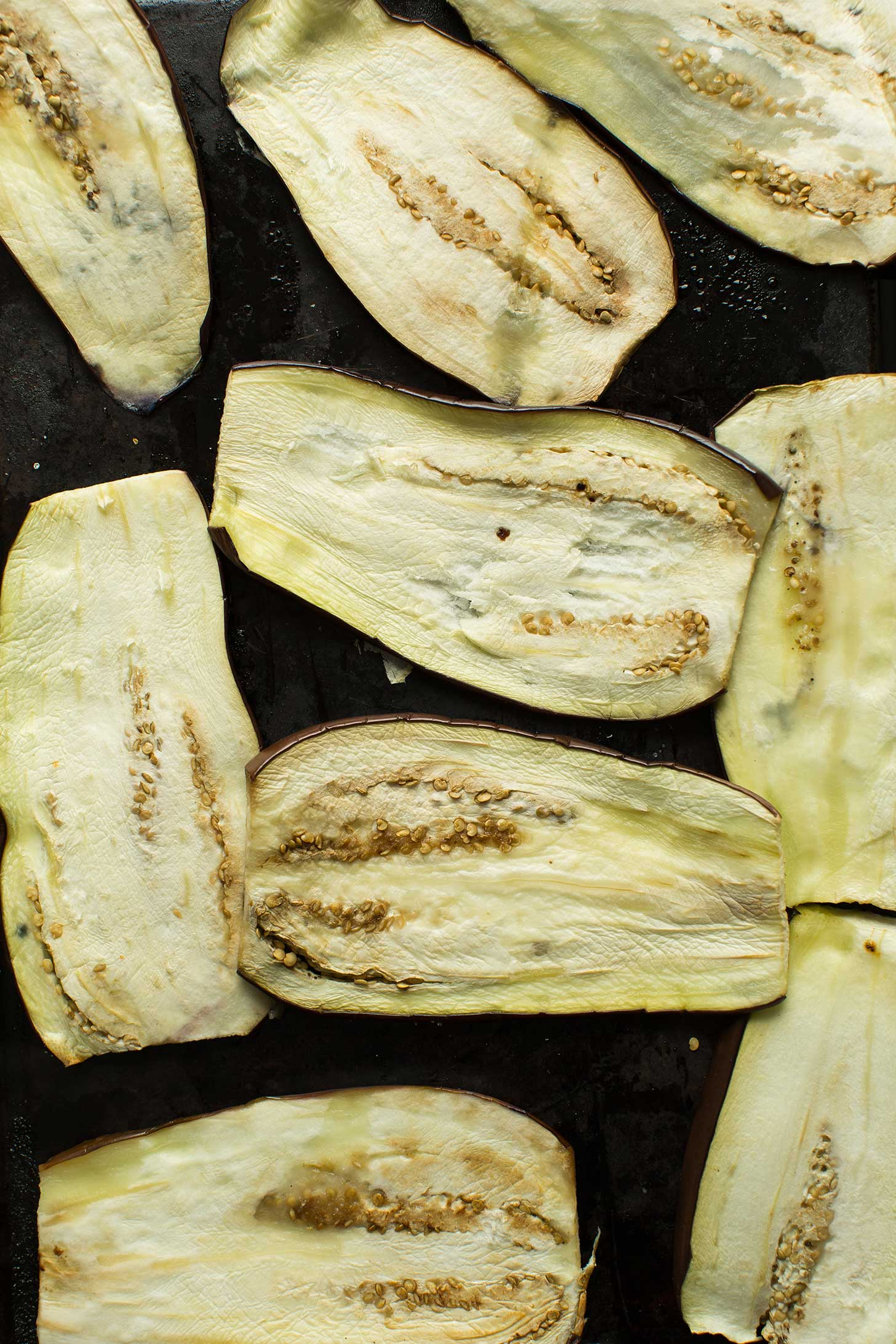 Baking sheet with thinly sliced eggplant for making easy gluten-free vegan lasagna