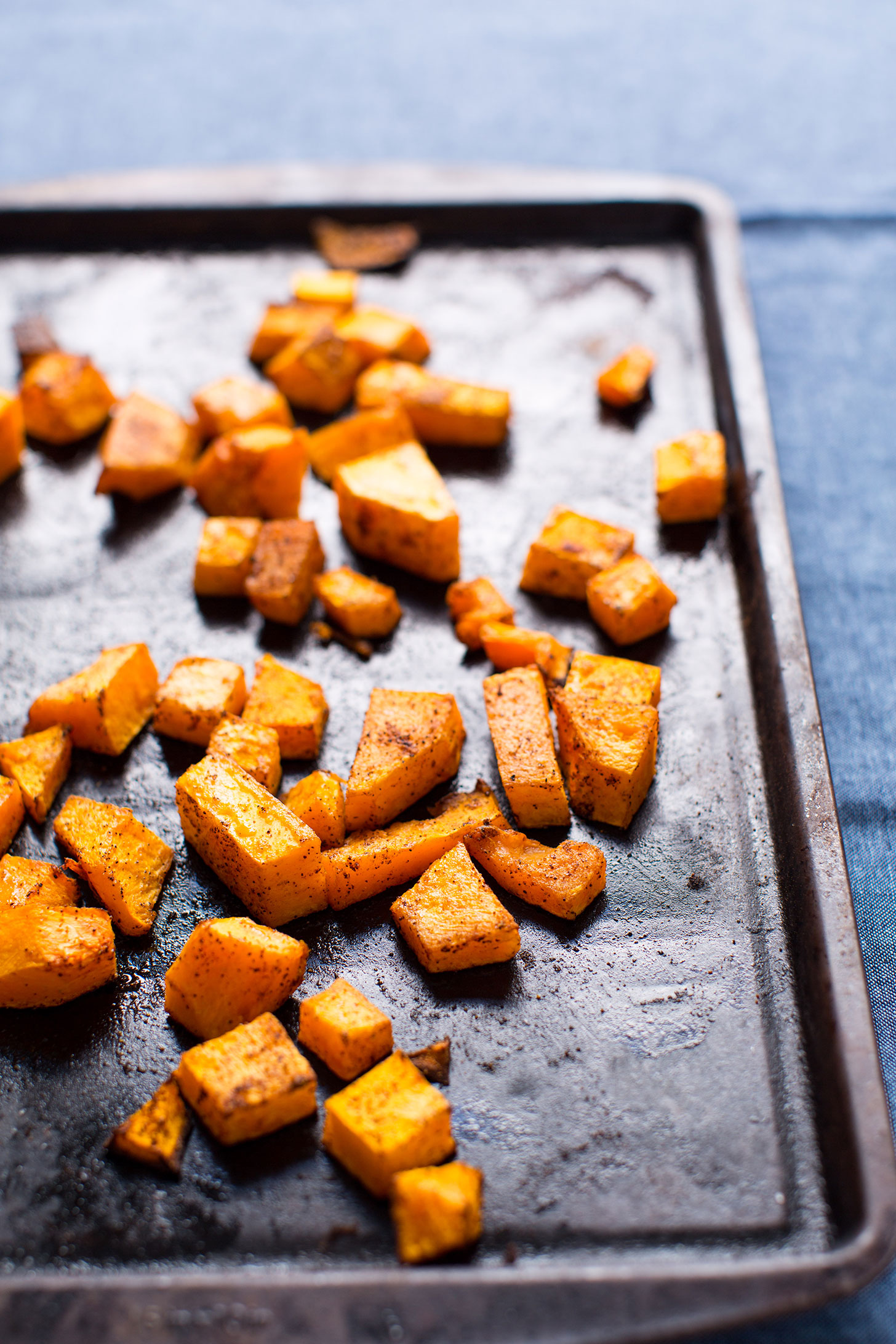 Baking sheet with freshly roasted spiced butternut squash for easy vegan tacos