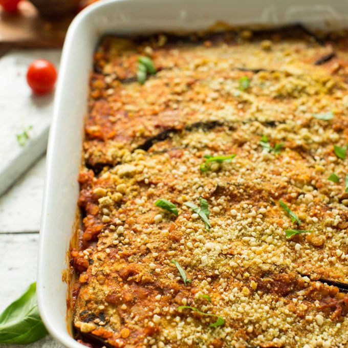 Ceramic baking dish filled with eggplant lasagna for an easy plant-based meal