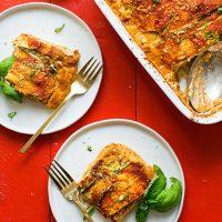 Pan and plates of Vegan Gluten-Free Zucchini Lasagna