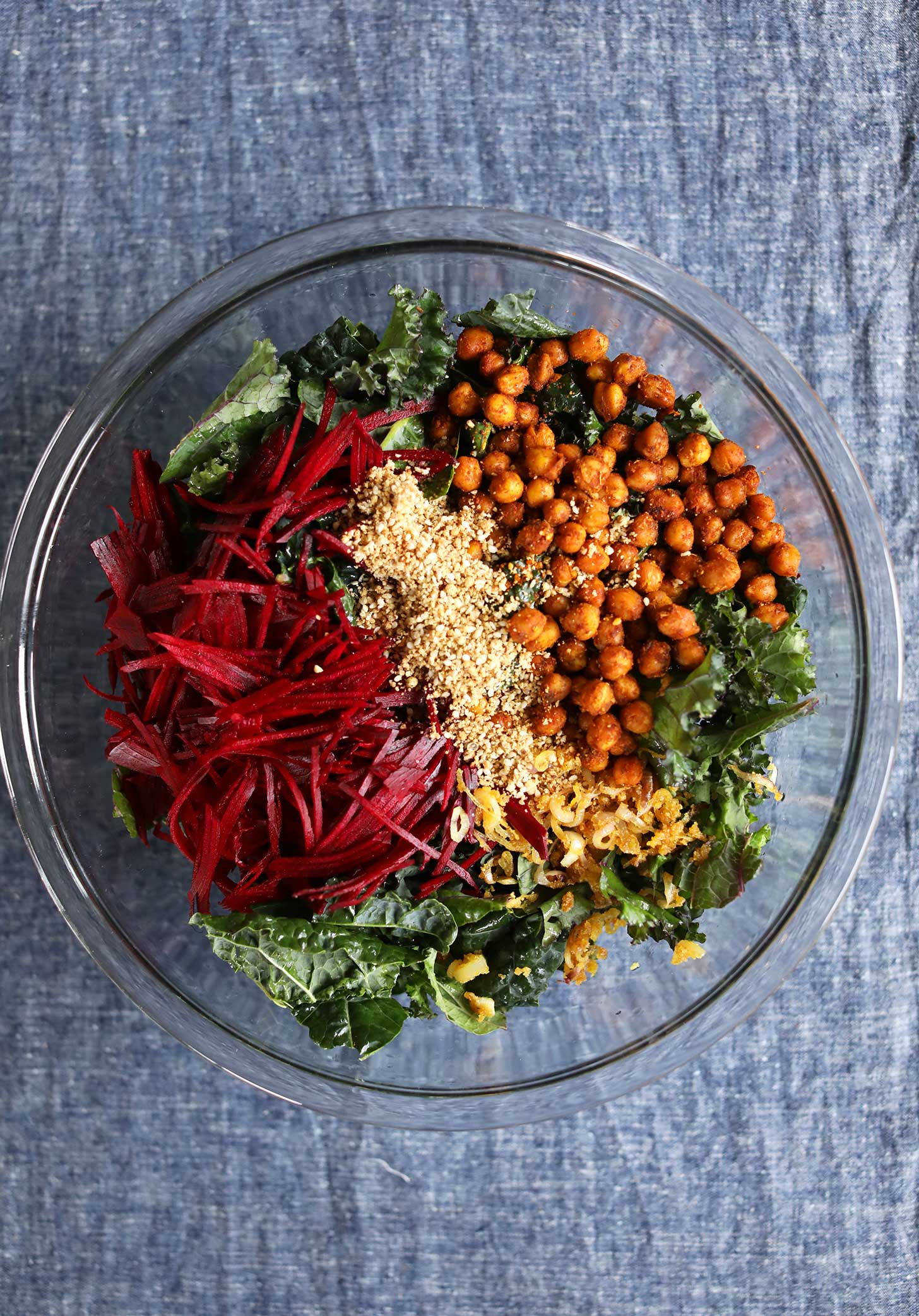Beautiful bowl of kale, beets, onions, dukkah, and chickpeas