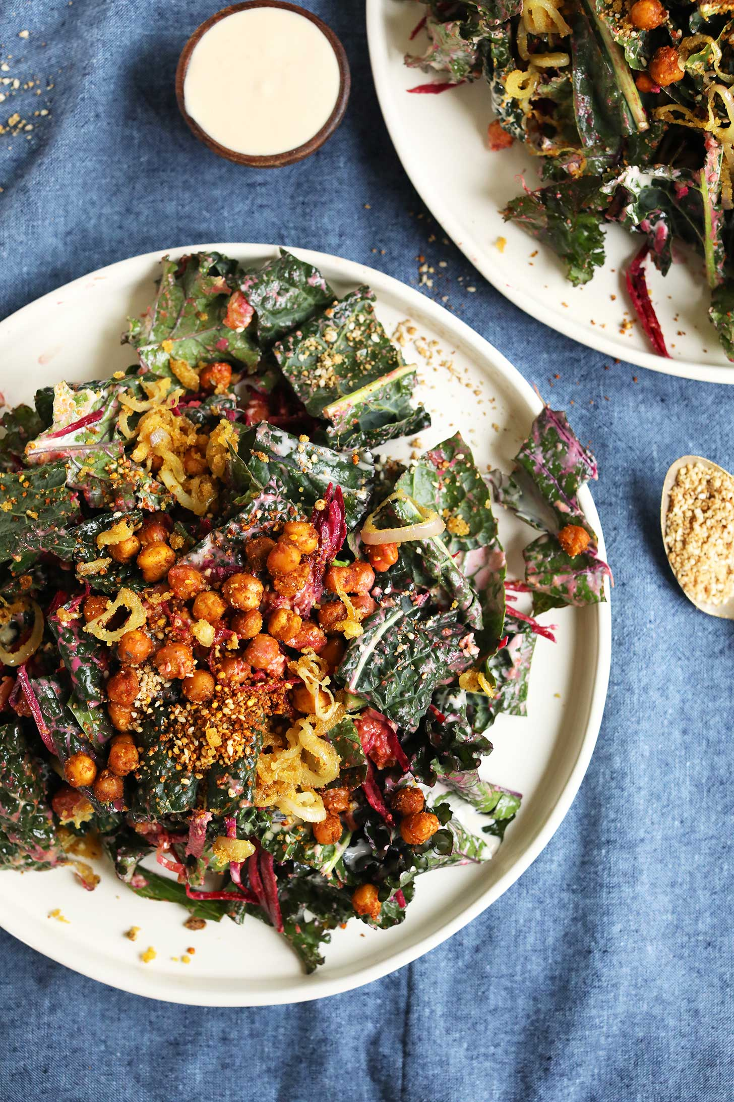 Big salad plate filled with Creamy Chickpea Kale Salad with Smoky Chickpeas ,Beets, and Dukkah