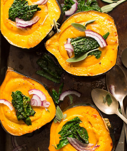 Delicious and comforting Acorn Squash Soup served in acorn squash bowls