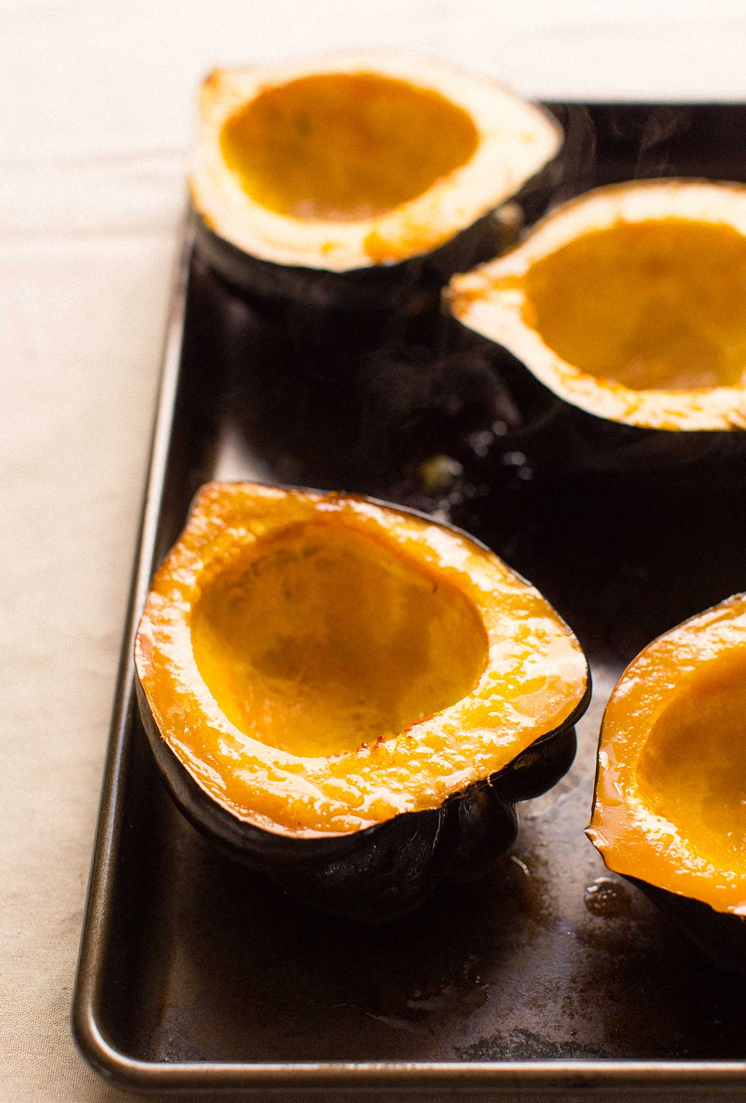 Freshly baked acorn squash halves for serving the Acorn Squash Soup