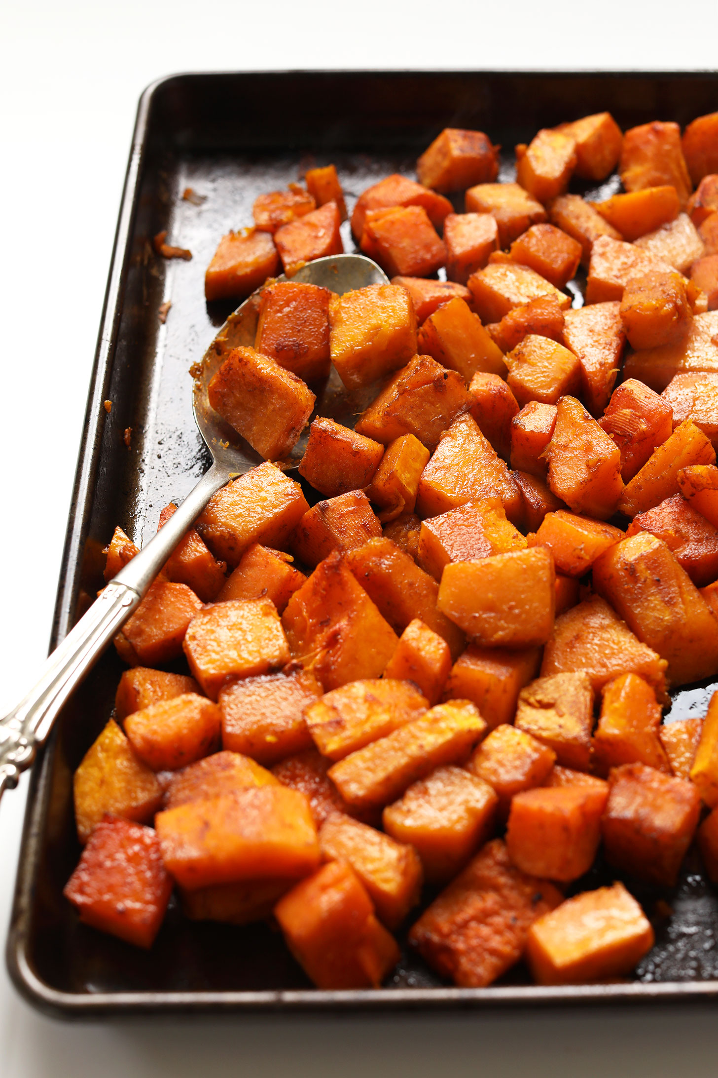 Baking sheet with freshly roasted Sweet Spicy Butternut Squash for a thanksgiving salad recipe