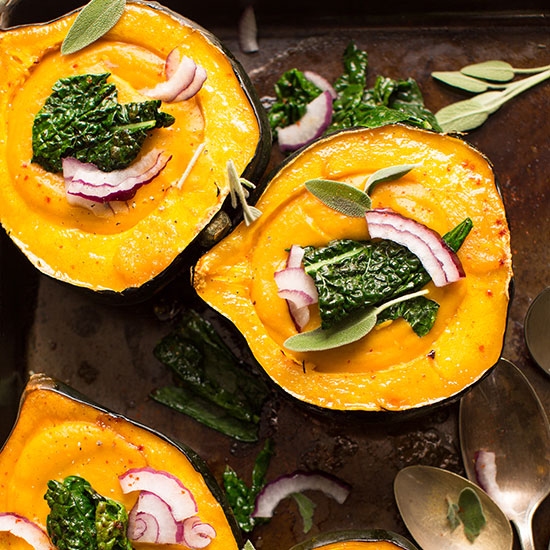 Baking sheet of Acorn Squash Bowls filled with creamy fall soup