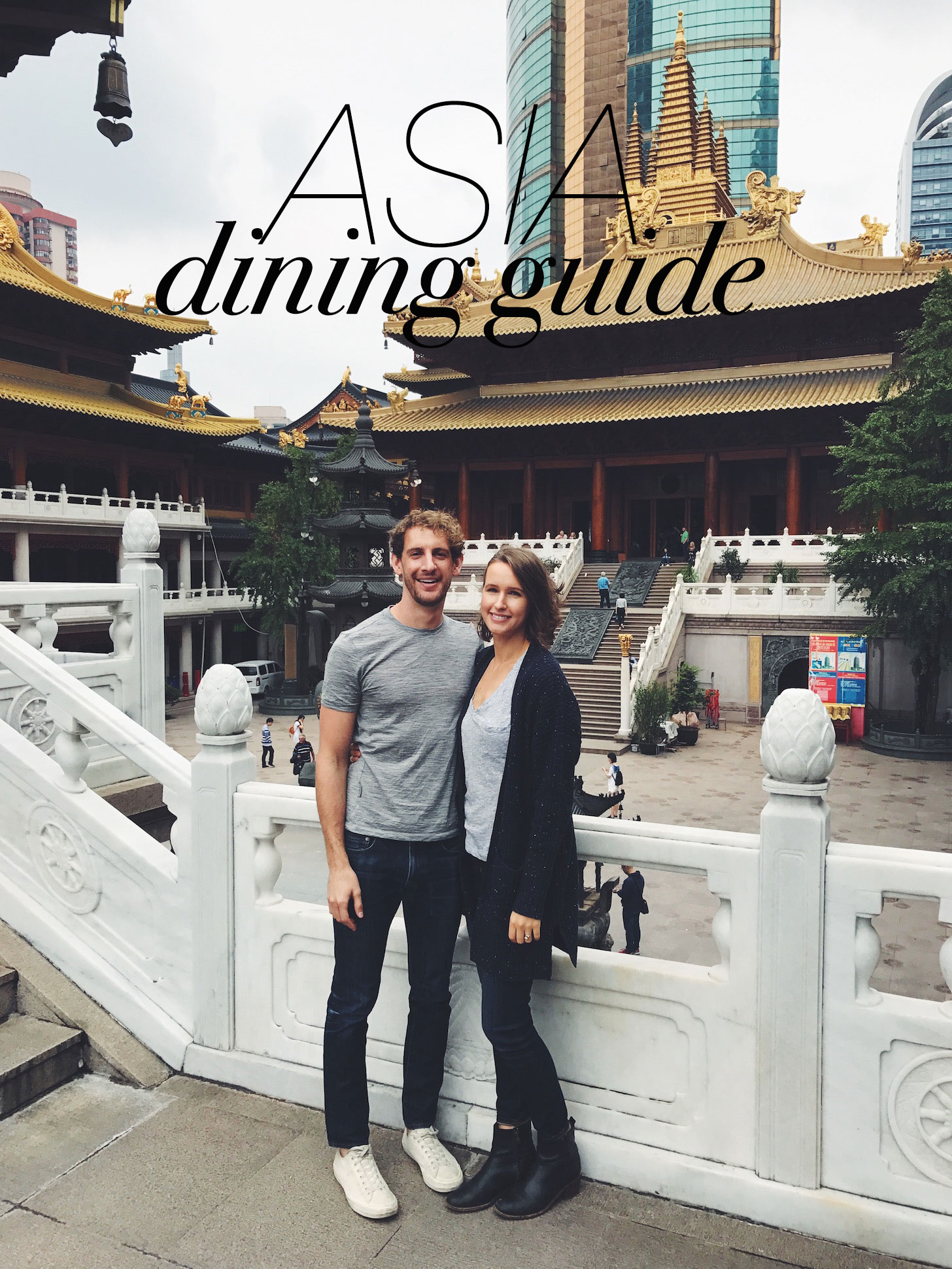 Photo of John and Dana in front of a template for our Asia Dining Guide