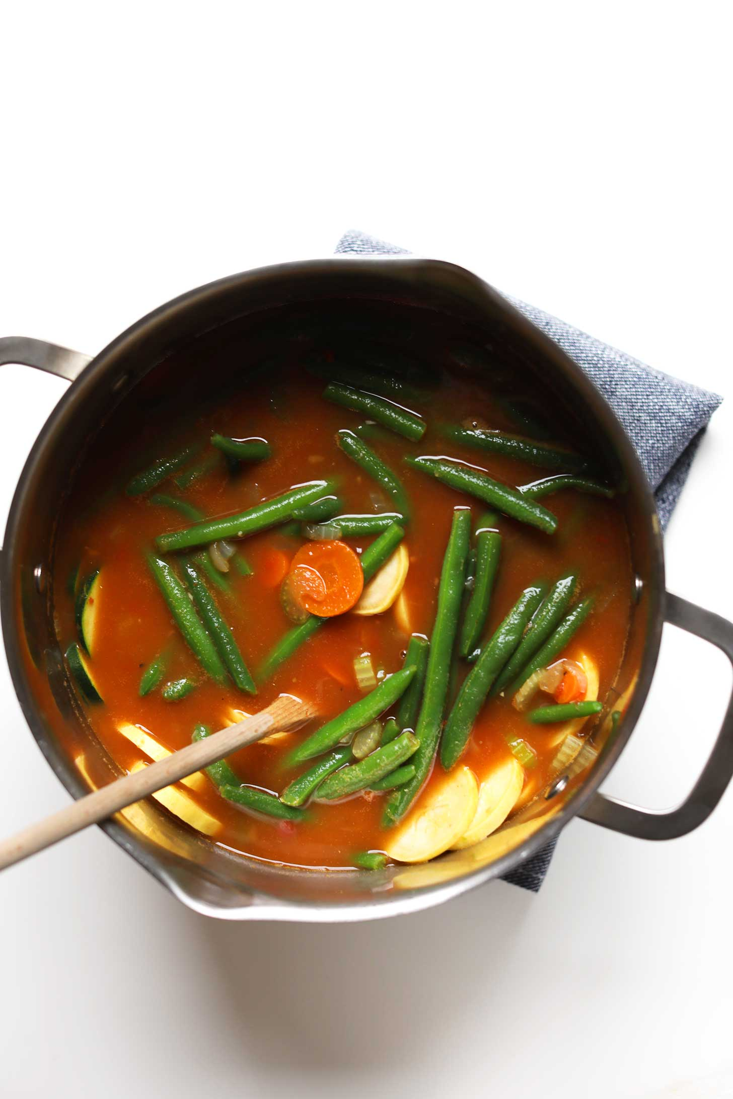 Pot of Mung Bean Vegetable Minestrone with fresh green beans floating at the top