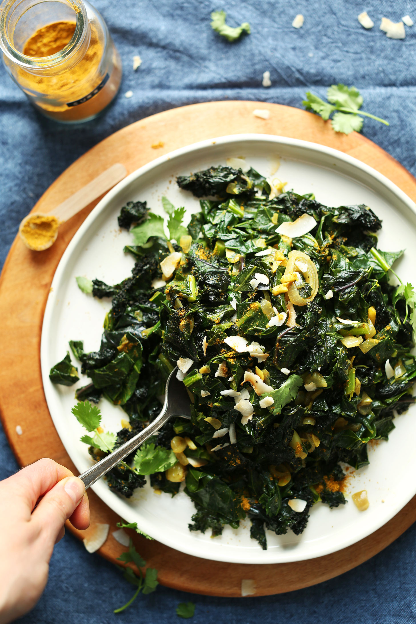 Grabbing a spoonful of our amazing Coconut Curried Greens recipe