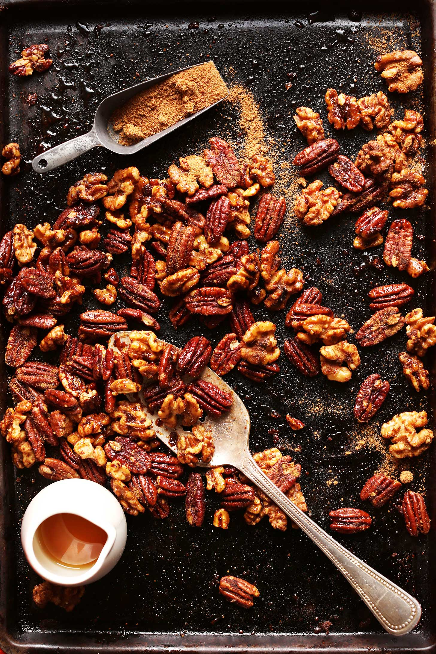 Baking sheet with walnuts and pecans ready to be made into Roasted Candied Nuts for the holidays