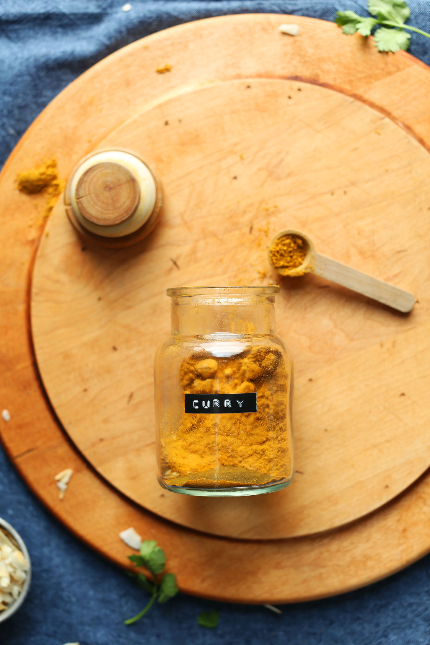 Jar and spoonful of our homemade curry powder