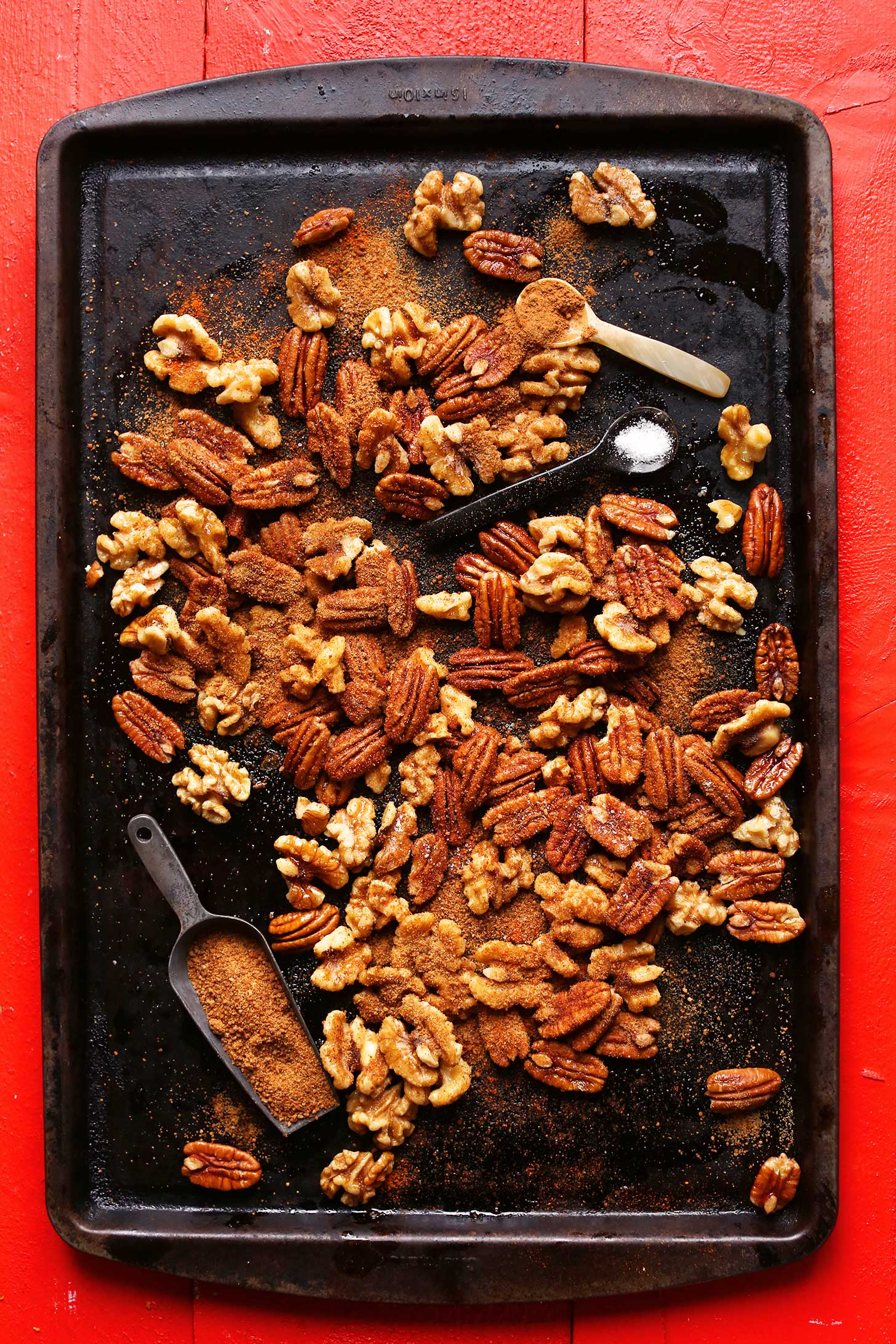Baking sheet with walnuts and pecans for making holiday spiced nuts