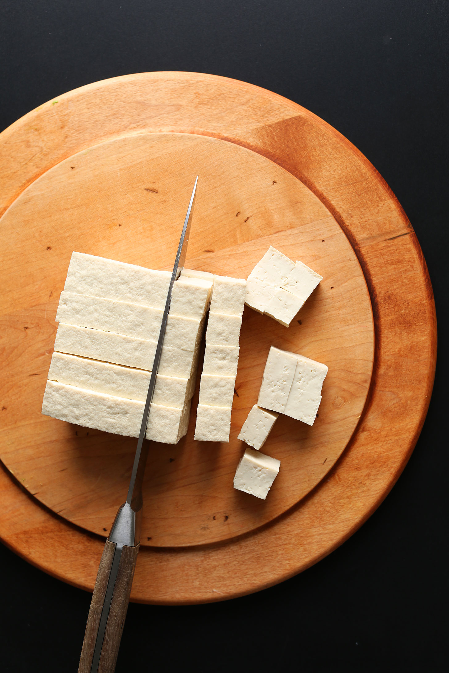 Showing how to cut tofu into cubes for easy Crispy Tofu