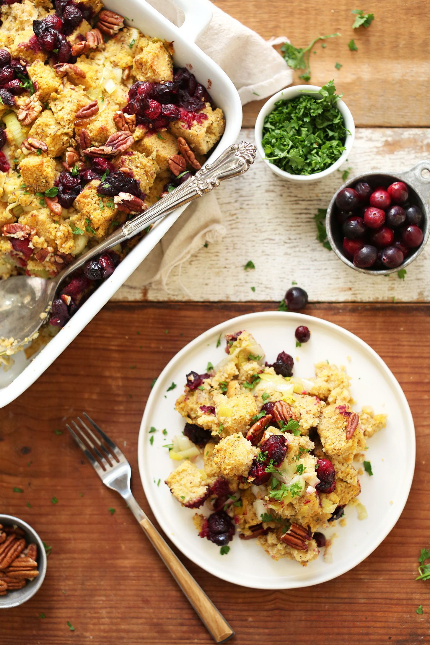 Baking dish and plate of Gluten-Free Vegan Cornbread Stuffing for Thanksgiving