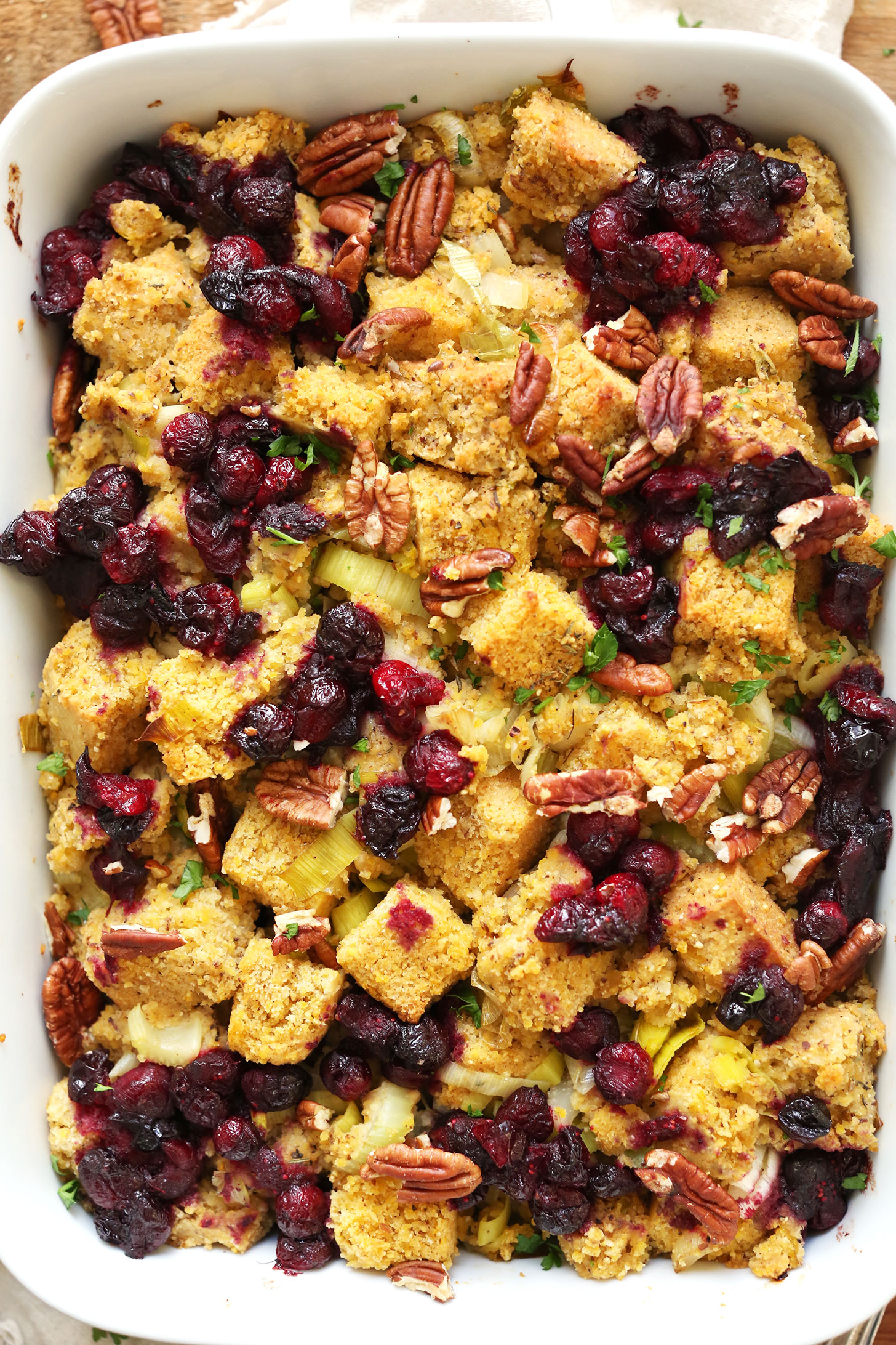Ceramic baking dish with flavorful savory vegan gluten-free cornbread stuffing