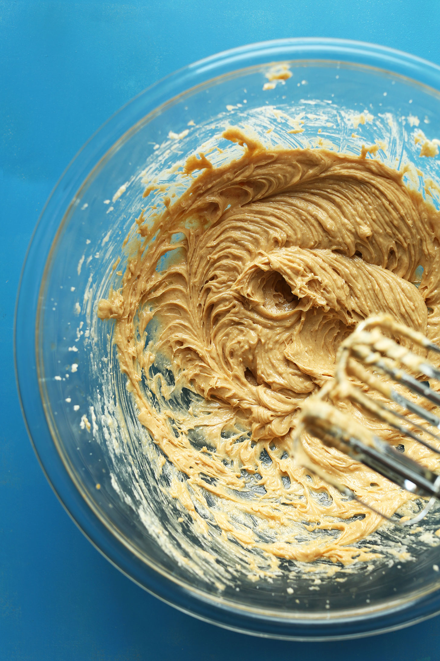 Whipping peanut butter for our amazing Peanut Butter Cup Cookies