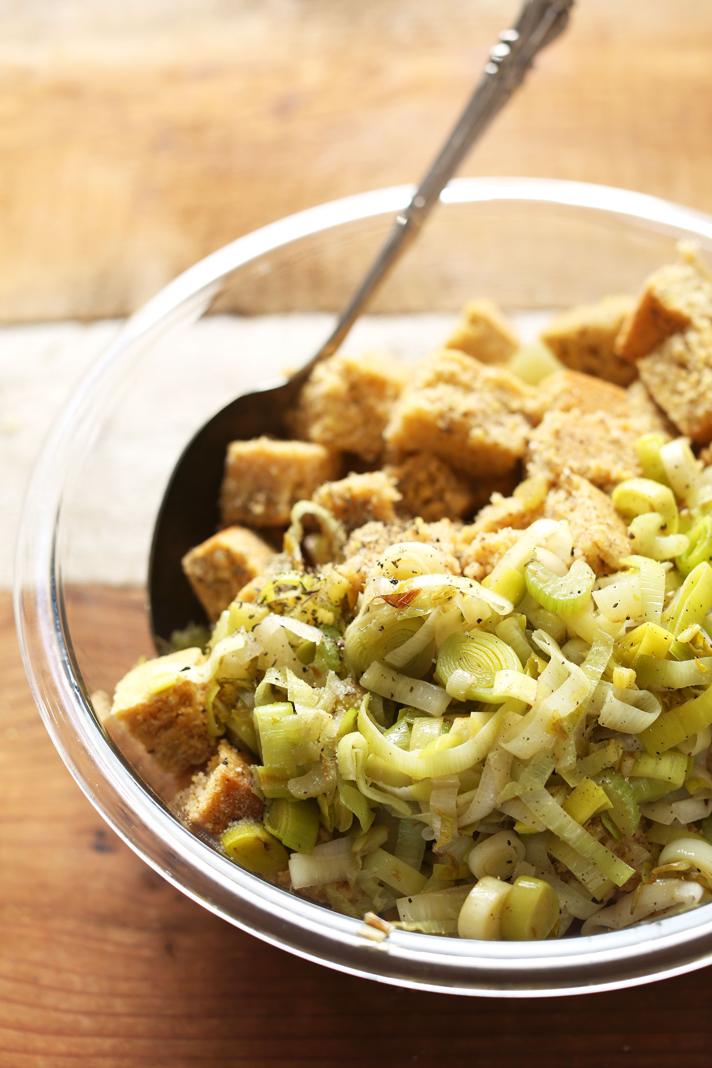 A bowl full of leeks and cornbread for making Vegan Gluten-Free Cornbread Stuffing