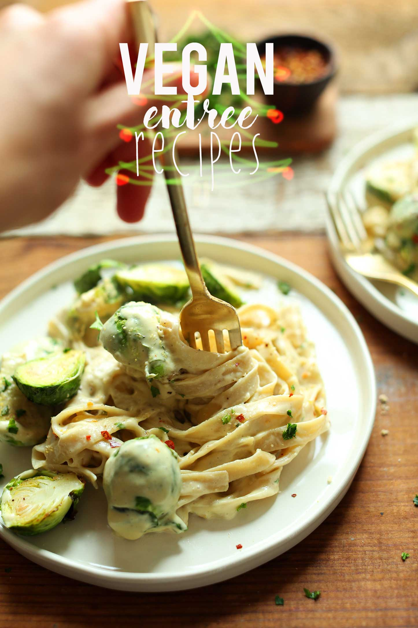 Swirling a fork in gluten-free vegan pasta which is one of our vegan holiday entree recipes