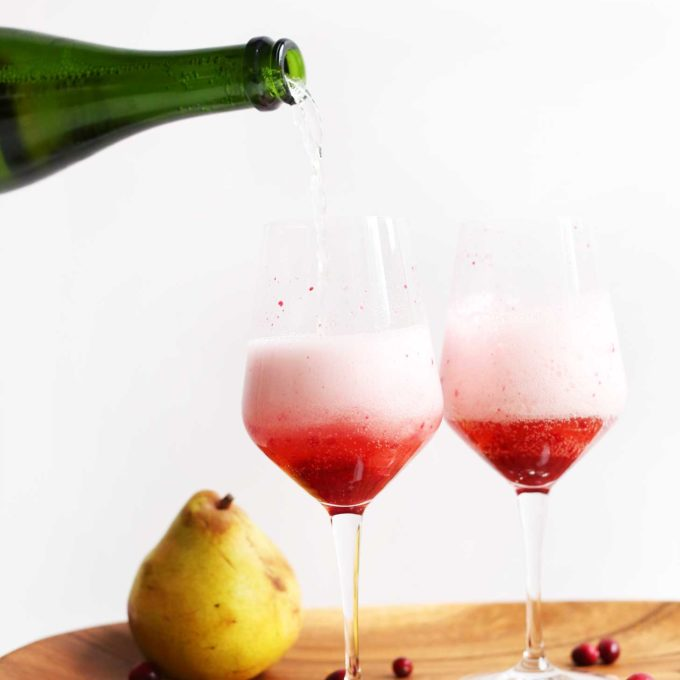 Making Champagne Mimosas with Cranberry-Pear Reduction for a New Year's bubbly treat