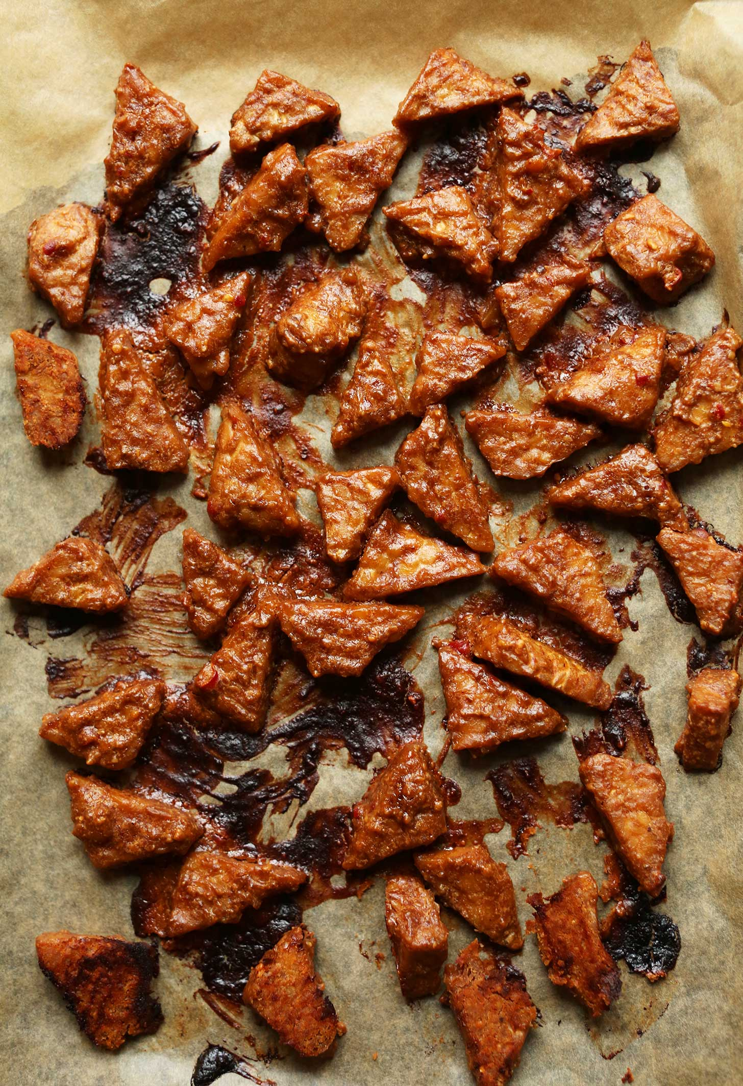 Parchment-lined baking sheet filled with freshly baked Peanut Tempeh