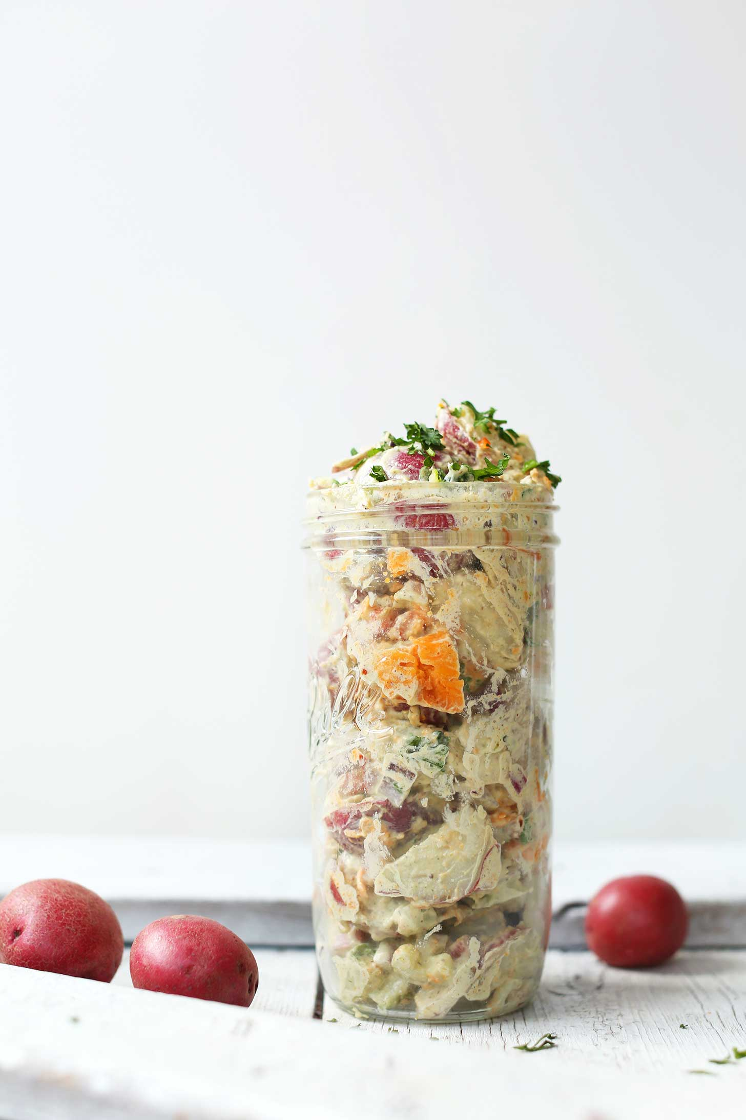 A jar filled with our hearty simple vegan potato salad recipe