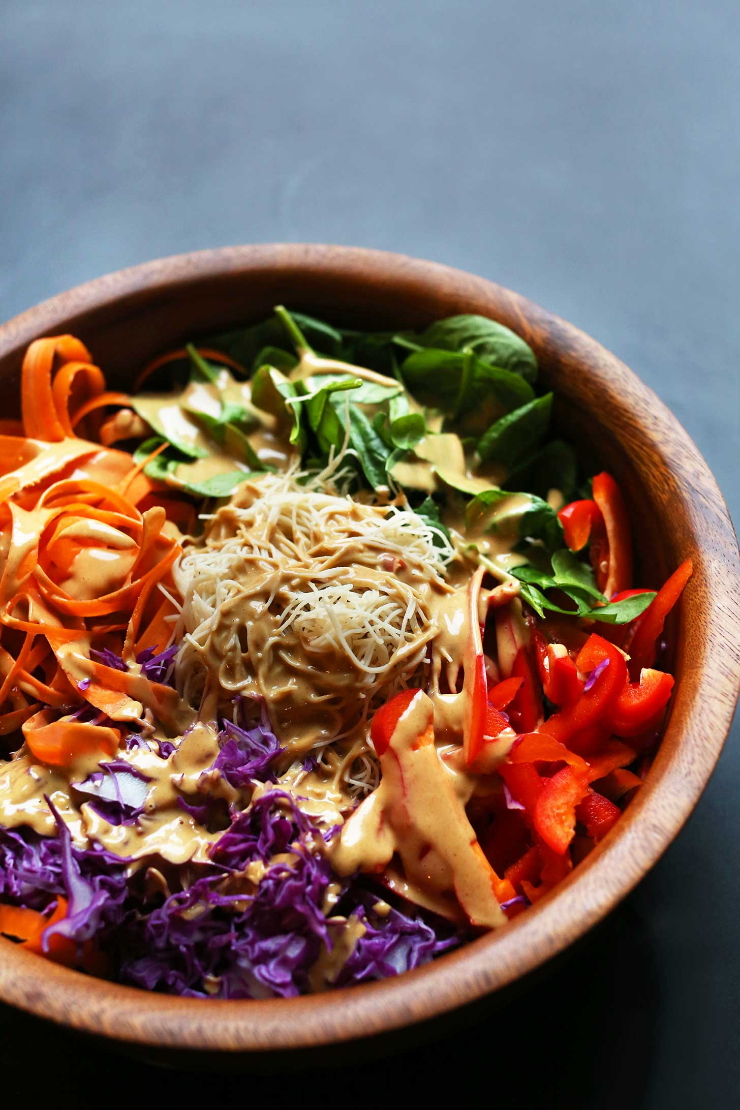 Big bowl filled with protein-packed vegan Thai Salad with Marinated Peanut Tempeh