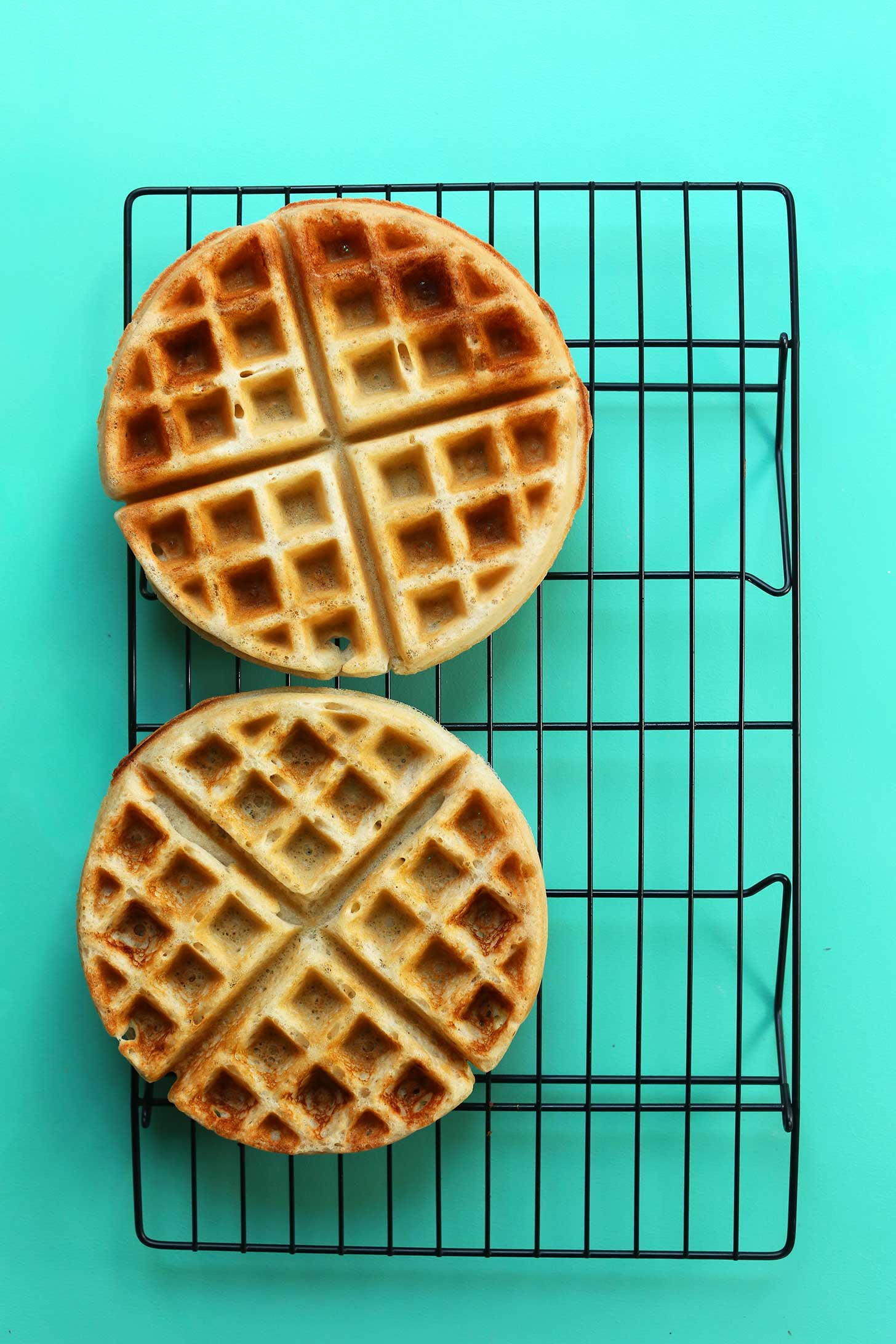 Two perfectly browned waffles made using our Vegan Gluten-Free Waffles recipe