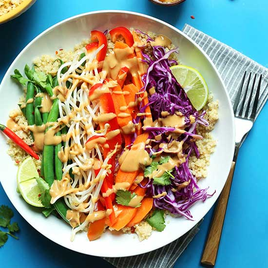 Big bowl of quinoa topped with vegetables for our Quinoa Gado Gado recipe