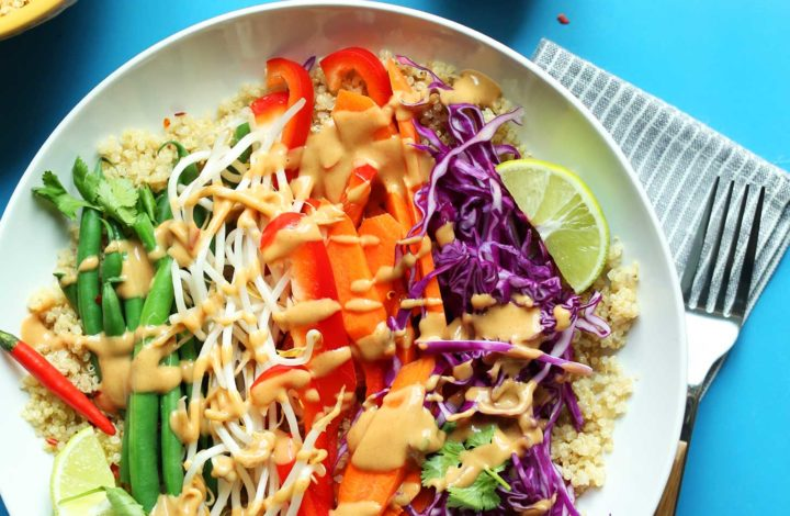 Bowl filled with Quinoa Gado Gadp with Veggies and Spicy Peanut Sauce for a simple healthy plant-based meal