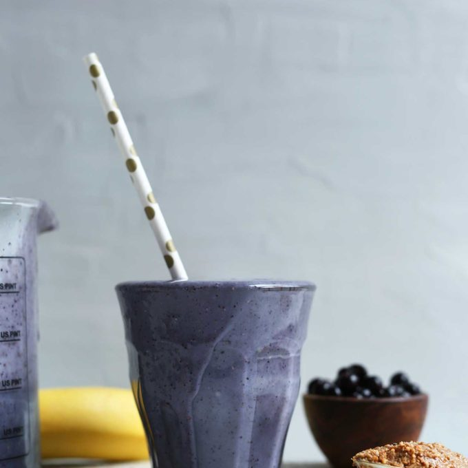 Glass with naturally-sweet plant-based Almond Butter Blueberry Smoothie with Chia and Flax