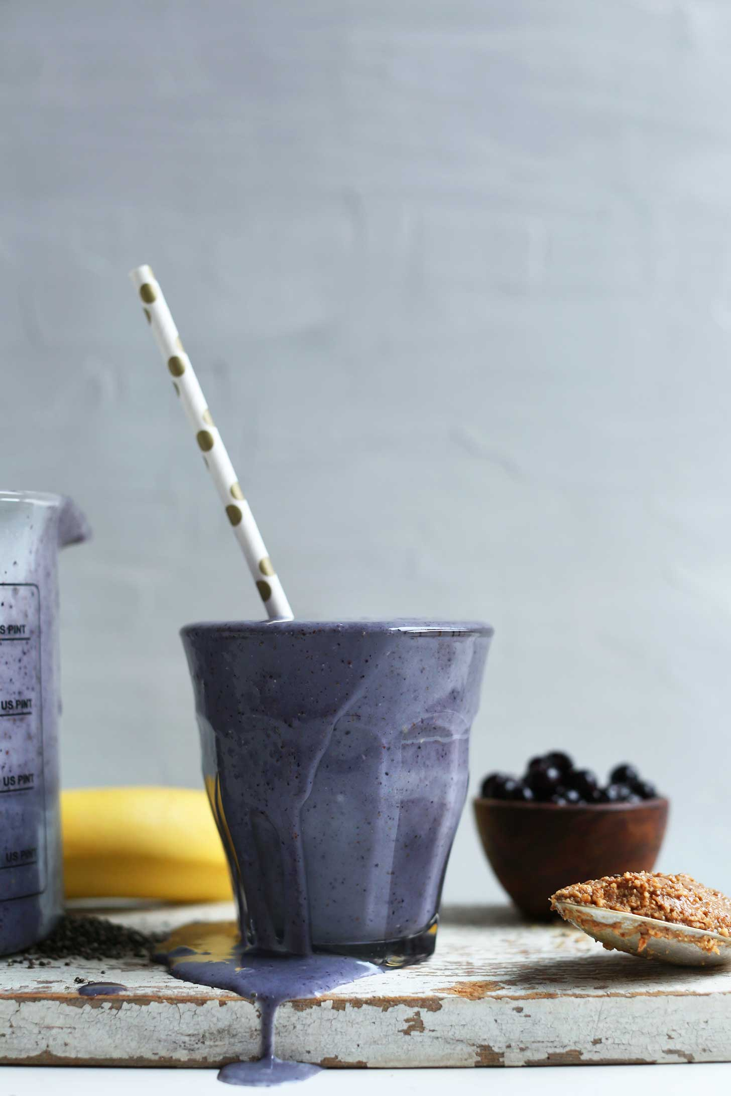 Glass of our nutrient-packed Almond Butter Blueberry Smoothie with Chia and Flax