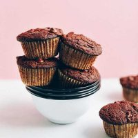 Stack of bowls piled high with Gluten-Free Chocolate Chocolate Chip Muffins