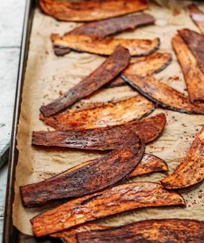 A baking sheet full of the ultimate vegan bacon alternative- Crispy Eggplant Bacon