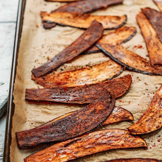 A baking sheet full of the ultimate vegan bacon alternative- Crispy Eggplant Bacon