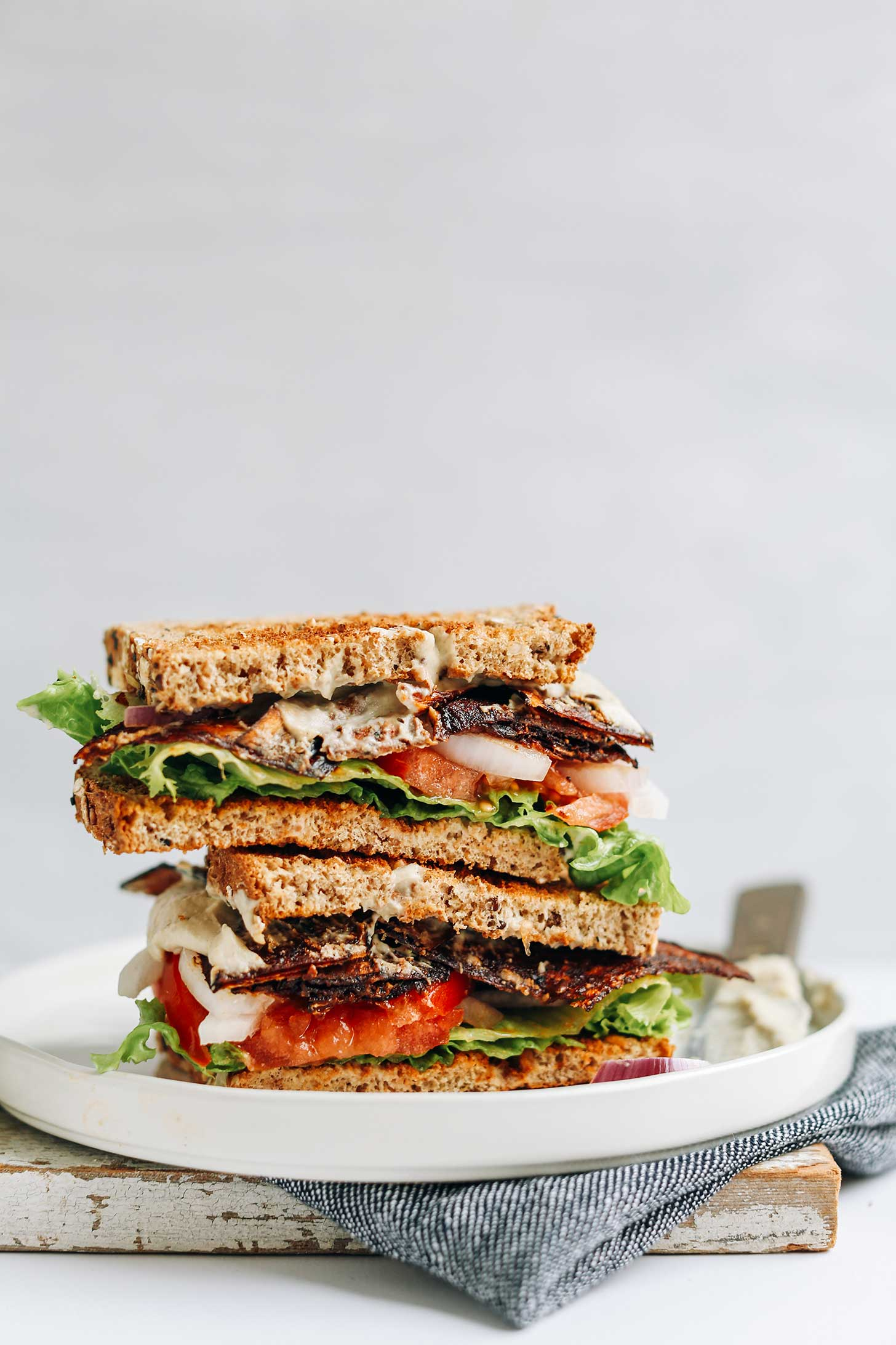 Stacked Vegan BLT Sandwich halves for a satisfying vegan lunch