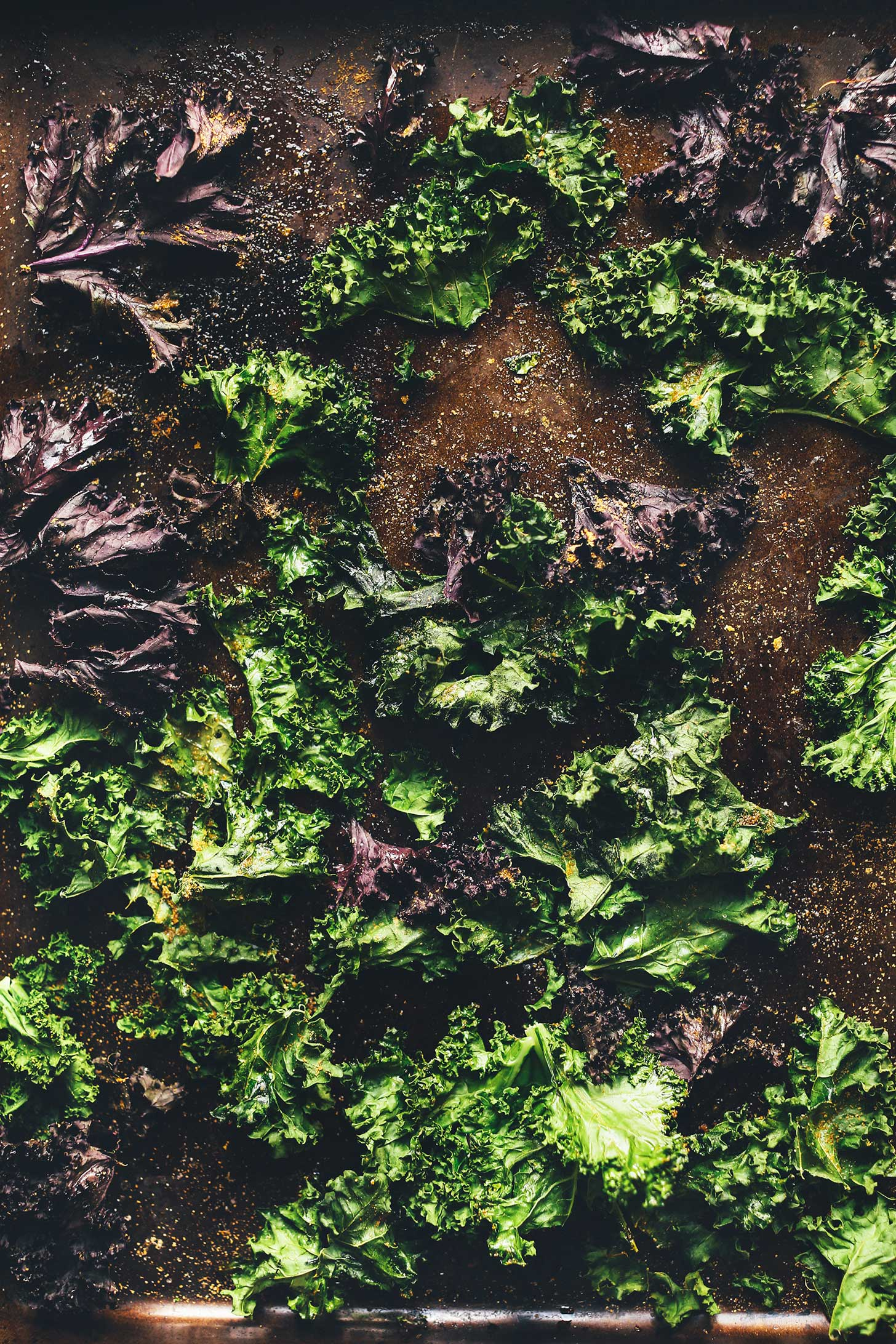 Baking sheet filled with a batch of our crispy Kale Chips recipe